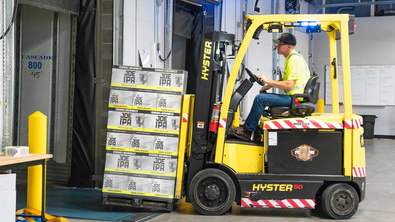 man-riding-a-yellow-forklift-with-boxes-1267324